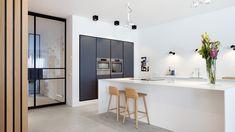 Dark kitchen cabinets, white kitchen island and wooden wall. Design by BNLA architecten Amsterdam. Best Kitchen Designs, Modern Kitchen Design, Open Plan Kitchen, New Kitchen, Kitchen Small, Floor Design, Home Design, Wall Design, Rustic Kitchen