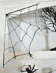 Make spiderwebs with glitter, glue, and wax paper - 25 DIYs for No-Sew Halloween Party Decor