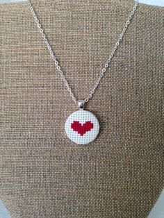 Items similar to Heart Embroidered Cross Stitch Pendant Necklace on Etsy Tiny Cross Stitch, Cross Stitch Needles, Cross Stitch Heart, Counted Cross Stitch Patterns, Cross Stitch Designs, Cross Stitch Embroidery, Learn Embroidery, Hand Embroidery, Diy Seed Bead Earrings