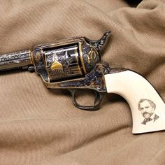 .45 COLT REVOLVER: To mark Colt's 175th anniversary, an exemplary .45 Colt revolver was commissioned in the Colt Custom Shop and this elaborately engraved and gold embellished single action is the result. A golden Colt factory dome and inlaid gold lines accent an incredible carbona blued finish, further set off by scrimshaw and ivory grip panels.