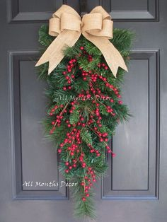 Red Berry Christmas Teardrop Wreath. Beautiful for Christmas home and door decor. Seasonal. Limited quantity available. - Designed on a artificial mixed pine teardrop swag - Features a natural burlap