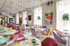Creative Restaurant Interior Design with Unique Decoration:Colorful Theme Restaurant With Square Dining Table White Flooring And White Wall Decor