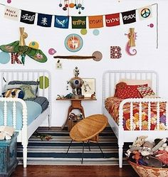 i like this setup for a shared bedroom. Matching beds with blue bedding on one and orange/red on the other w/ small storage for toys or whatever at the foot of the bed.