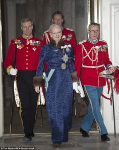 Queen Margrethe, dressed in a navy brocade coat with brown fur sleeves, was also in attend...
