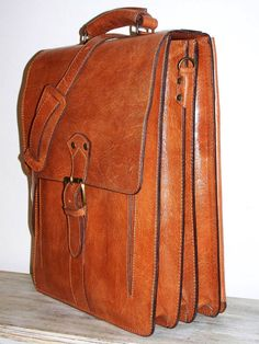 Leather messenger bag that would hold my large laptop. Vertical orientation. Want. Don't need.