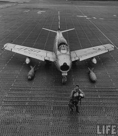 United States Air Force jet on airstrip. Korea, 1953.