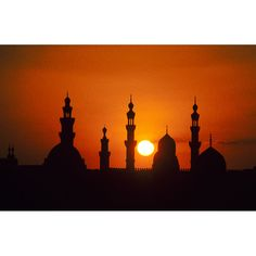 Egypt ~ Sunset in Old Cairo through the minarets of Sultan Hassan and the Rifai mosque