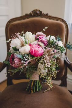 protea, peony, eucalyptus bouquet, photo by Lauren Fair Photography http://ruffledblog.com/whimsical-woodland-wedding #flowers #pink #weddingbouquet