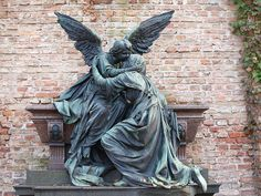 Angel on grave hugging woman by symboter, via Flickr