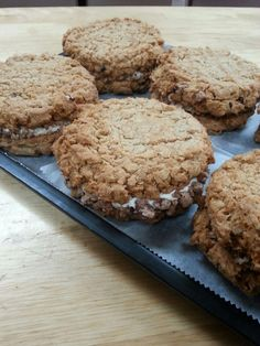Oatmeal sandwich cookie with bourbon white chocolate filling and candied pecans.