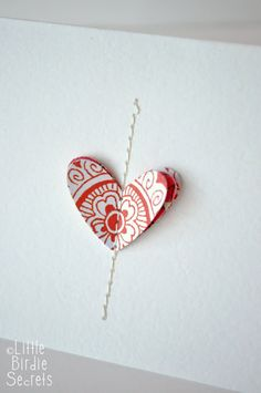 layers of stitched hearts