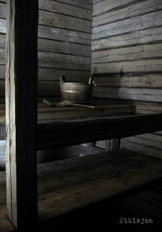Inside a dark and cosy, dim-lit finnish sauna