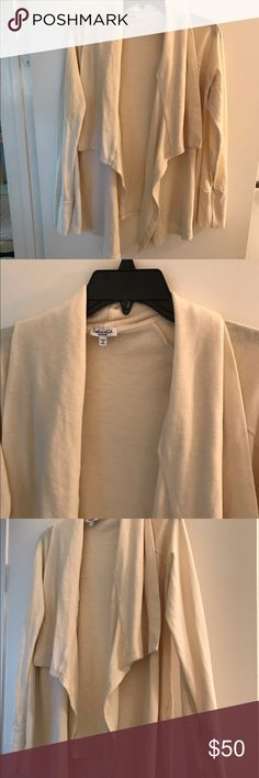 Splendid wrap cardigan, EUC. Cream colored cardigan from Splendid. So soft and comfy. Worn once or twice, excellent used condition, I just reach for other pieces. Size medium. 50% poly, 38% cotton, 12% rayon. Smoke free home. Splendid Sweaters Cardigans
