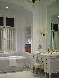 Litchfield Designs: Elegant master bathroom with arched bath alcove. White porcelain soaking tub in bath ...