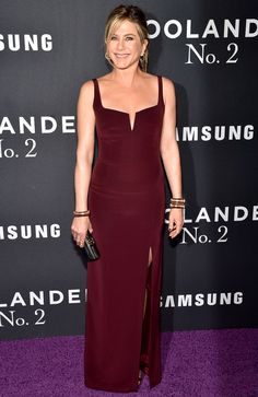 JENNIFER ANISTON in a deep red, thigh-high slit Galvan dress accessorized with a matching manicure and Sidney Garber jewelry, the star stepped out to support husband Justin Theroux, who's a screenwriter for and also makes an appearance in Zoolander 2 at the movie's premiere in N.Y.C.