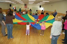 parachute games for storytime. i remember doing this!!! i also remember it being my favorite thing ever. :)