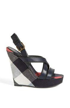 Pairing these Burberry wedge sandals with some skinny jeans.