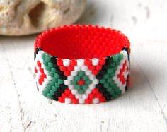 Colorful ethnic style peyote ring. Ring made of Miyuki delica seed beads.  Width - 13 mm Size - 8.5(US)  More peyote rings (seed bead rings) from my shop you can see here: https://www.etsy.com/shop/HappyBeadwork?section_id=18818205