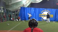 Pitchers throwing bullpens in the High School Winter Training Program; January 2014