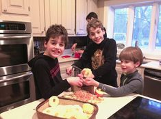 Boys Slicing Baked Apple