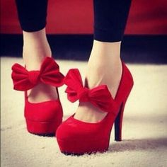 Red, stiletto heels, with accented bow. ** If these were just a tad sleeker (not so platform) these would be perfect!