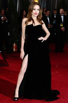 February 26 2012  In a black velvet Atelier Versace gown and Salvatore Ferragamo heels at the 2012 Oscars. The dress became one of the evening's most talked about looks with her right leg inspiring its very own Twitter account, which gained 28,000 followers in 24 hours.