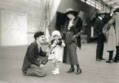 Charlie Chaplin visits with Mary Pickford and her niece Gwynne circa 1925.