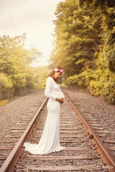 Maternity photo session empty railroad tracks with the rustic look
