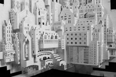 From flat sheets of paper, entire cities emerge, rich in unexpected details like balconies, tiny windows and even little people. Dutch artist Ingrid Siliakus uses an initial 90-degree fold to give her miniature cityscapes depth and dimension, with an end result that is reminiscent of pop-up books.