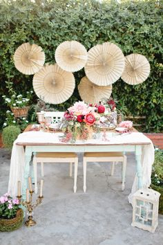 sweetheart table with a backdrop, photo by Megan Welker Photography, styling by Beijos Events http://ruffledblog.com/garden-romance-wedding-inspiration #weddingideas #sweethearttable