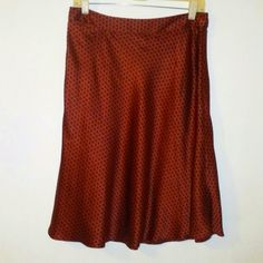 Banana Republic silk skirt Shell 100% silk LINING 100-% acetate Red  graphic print A line skirt Fully lined 1 small pocket at waist Button and zipper closure on the side EXCELLENT like new condition Banana Republic Skirts