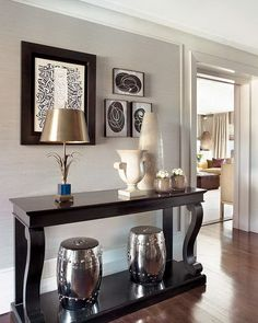 Make a wall a beautiful focal point with a vignette such as this one.