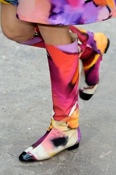 Go-Go Boots This season's knee-high boots are made of plasticky, patent-looking leather, with a toe shape that's more squarish than round. They're for mod ladies of this generation, and will go with everything from skinny jeans to little shift dresses. Chanel
