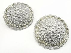 Pair of round antique domed silver shoe clips. Marcasites surrounded by a row of…