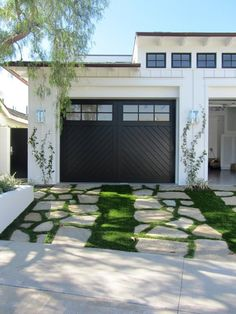 Transform and update the exterior of your home instantly by replacing garage doors with a more modern garage door design. We're showing you garage door styles to consider and what you need to think about when choosing modern garage door designs. Garage Door Design, Modern Garage Doors, Exterior Design, Modern Farmhouse, Suburban House, Door Design, Garden In The Woods, Home And Garden, House Exterior