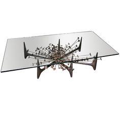 60's Iron and Glass Sculptural Coffee Table From Adesso    http://adesso.1stdibs.com/store/furniture_item_detail.php?id=607185