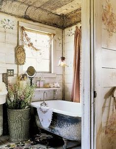 I like rustic bathrooms and you couldn't get more rustic than this! I love the tin ceiling!!!
