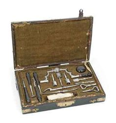 A FRENCH TREPANNING SET  Leseur, late 18th century  signed on the drill LESEUR also with a punched maker's mark of a crown over an A, drill-heads, perforators, elevators, lenticulars with turned wooden handles, in fitted case. Surgical instruments for relieving pressure on the brain.