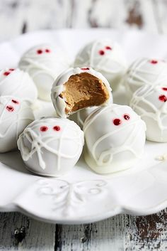 Whip up a batch of Mini Pumpkin Cheesecake Mummy Truffles for Halloween with this easy dessert recipe.