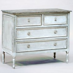 """Gabby Furniture Caroline Chest. great for bedroom or living room. inspired by the formal dressing rooms of the 18th century. crafted of mindi & mahogany. Fluted tapered legs & antique white finish. Hand painted burlap adds texture to the front of the 4 drawers, each trimmed w/ delicated beadwork and dressed w/ French-style hardware. 37""""W x 19.25""""D x 36""""H. for $1,248"""