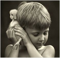 black and white boy picture with a goose