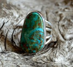 """A personal favorite from my Etsy shop at www.gonetogallup.etsy.com   Follow me on Instagram @gonetogallup   This is a beautiful natural cut and polished Native American Indian southwestern style Kingman turquoise ring set on sterling silver. The ring is shaped around the stone so that you can see the turquoise in its natural form. The turquoise used to make these earrings comes from the Kingman mines in Arizona.    The ring is size 9 and the dimensions are 1 and ¼"""" long by ¾"""" width"""