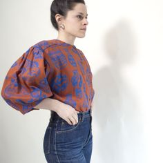 Electric Blue on Rust all-linen Antonia Blouse, great tucked in to high waisted jeans, even better as a jacket over a white shirt, screen printed with artist Maggie Boyd's original drawings. Linen Blouse, Ruffle Blouse, Screen Printing Process, Sustainable Textiles, Clothes Horse, Electric Blue, High Waist Jeans, What To Wear, Workshop