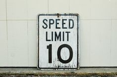 10mph wooden speed limit sign