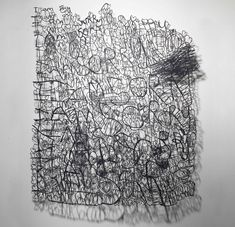 Annie Vought - hand cut letters, messages with all the paper cut away, leaving only words
