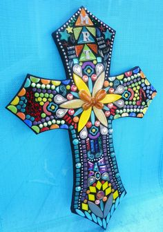 **PLEASE READ THIS ENTIRE DESCRIPTION BEFORE YOU ORDER**. Let me know if there is anything else youd like to know that I havent answered here. Thank you!!** This mosaiced cross is certainly unique and one-of-a-kind. It is 18 tall and 12 wide. This colorful cross is what I call my Wild & Funky style. It consists of personalized silver initials of your choice, turquoise howlite stones, ceramic petal shapes, a 3D glass butterfly focal point and other silver embellishments including silver ba...