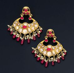 AN PAIR OF ATTRACTIVE DIAMOND, RUBY AND PEARL EAR-PENDANTS   Each designed as a stylised floral crescent set with table-cut diamonds within foiled surrounds to cabochon ruby detail suspending a ruby bead and pearl fringe to the later three-stone ruby surmount, the reverse finely chased with foliate motifs, South Indian, mid - late 18th century, 4.5cm. high, (ruby surmounts adapted)