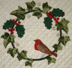 Robin in autumn. A cheerful robin in a holly and ivy wreath makes a great design for Christmas and the holiday season. A best selling pattern and a popular choice for workshops. Freezer paper templates included. For a setting idea for the design  see  Robin in Autumn  Size: 10½in square.