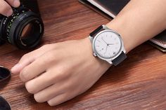 The Simple CMK White One of our oldest and popular watches. Tags: Simple watch for men Minimalist watch Wristwatch Simple Watches, Watches For Men, Popular Watches, White Backdrop, White Man, Stainless Steel Case, Leather Case, Quartz, Minimalist
