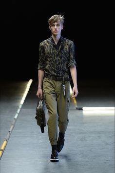 Hogan designer Simon Holloway unveiled his spring-summer 2016 menswear collection during Milan Fashion Week. The concise lineup evoked a sporty attitude with relaxed proportions and a bold, splashy approach to staples. Worn with trainers, trousers were finished with elasticated cuffs like joggers, shirts adorned in prints, suits produced slouchy and silk pants likened to pajamas.